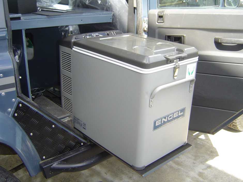 Engel MT45 fridge/freezer on slide behind driver's seat