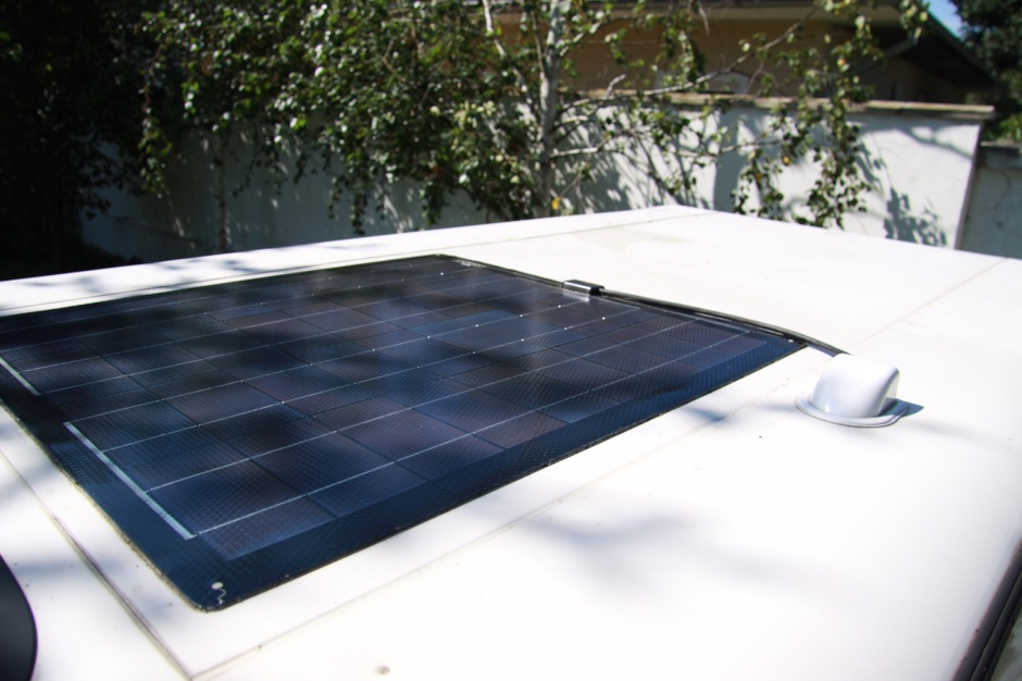 GB-Sol 85 watt solar panel glued to roof of Defender
