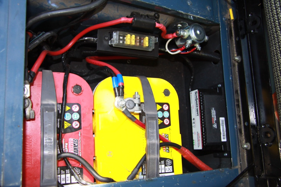 Nice neat job in the battery box under the seat. Red top and yellow top Optima batteries, solar panel regulator and split-charge system