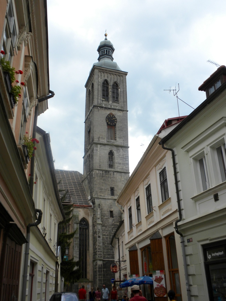 Narrow alleys with the tower of St. Barbara's Church looming overhead