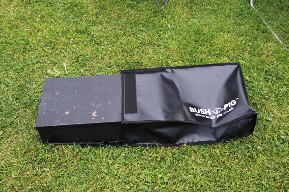 Bushpig braai partially inserted into Bushpig case/bag