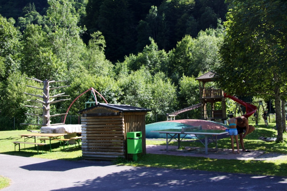Kids playground, complete with inflated bouncy trampoline, treehouse slide, etc.