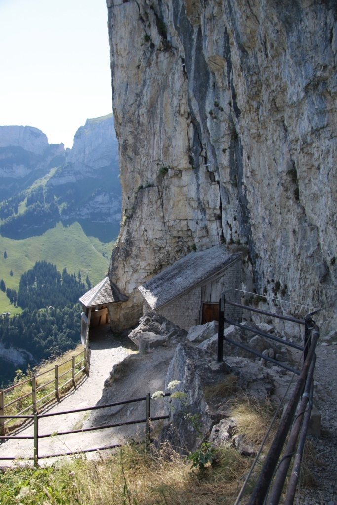 A covered bridge on the side of the mountain, to reach the Berggasthaus