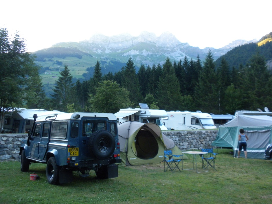 Camping plot with mountains as a backdrop