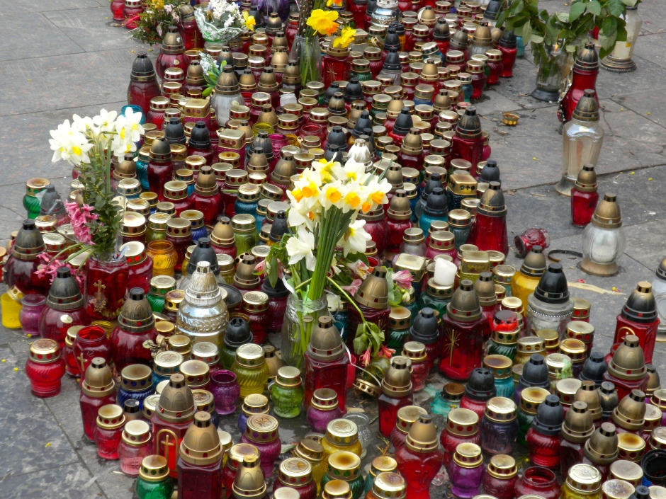 Candles and flowers left at the memorial