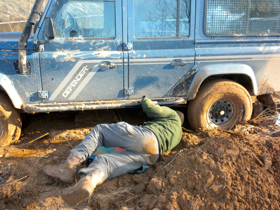 After a while, I had to lay under the vehicle in order to clear the mud that was under the diffs and prop shafts.