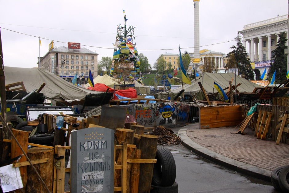 Protestors making themselves at home on the Maidan. Note the fence and gate, featuring a police shield