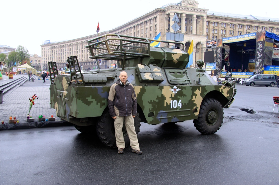 Next to a captured military vehicle