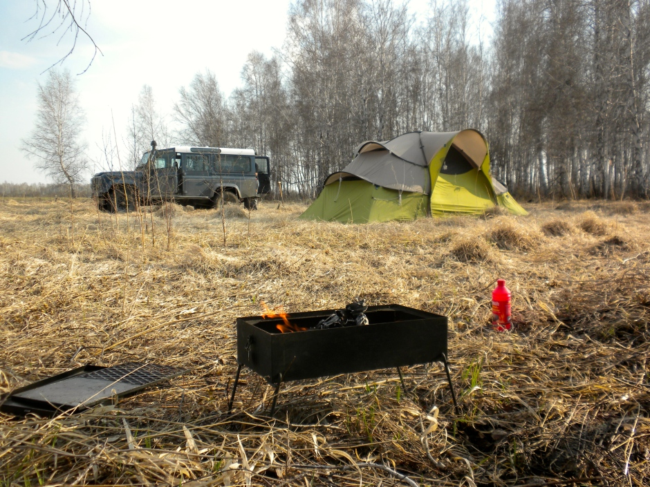 The tent is pitched and the Bush Pig is lit, preparing for dinner