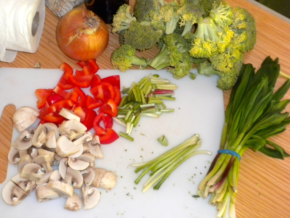 Preparing veggies, including the wild spring onions, for the pasta sauce