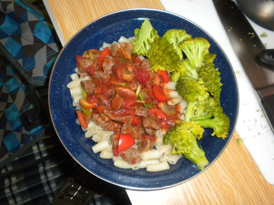 Camp-stove cooking: Pasta with beef and vegetable sauce and a side of broccoli.