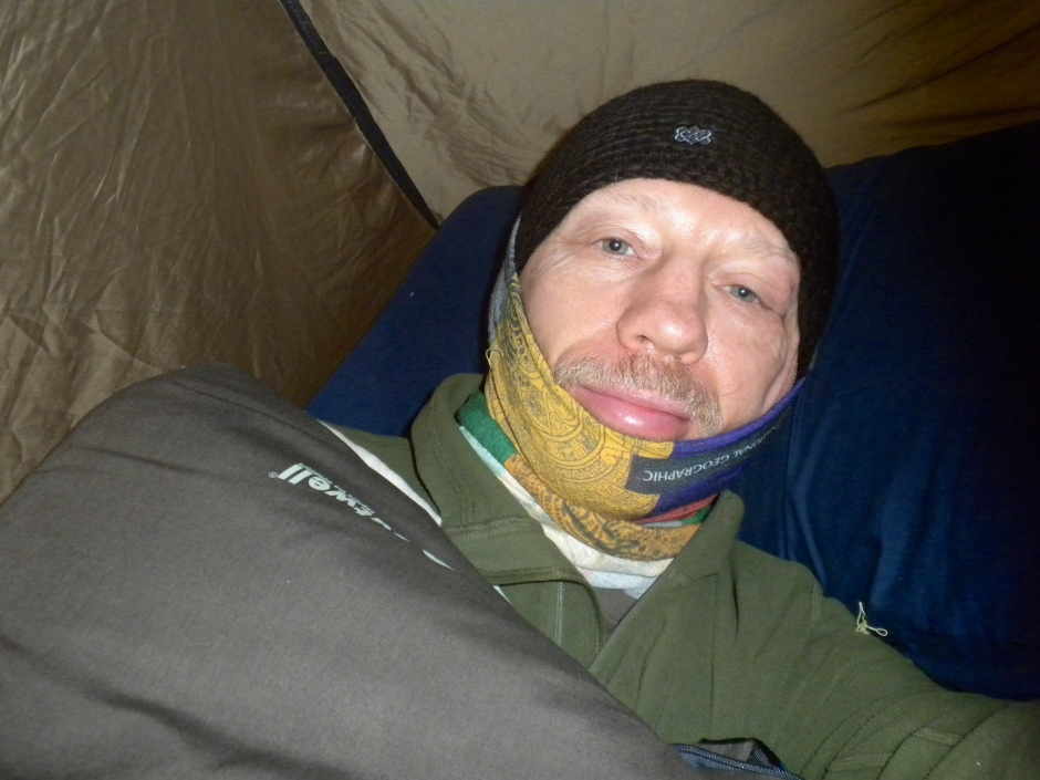 A selfie of me getting up in the morning with hat and buff in place to keep my head and neck warm at night