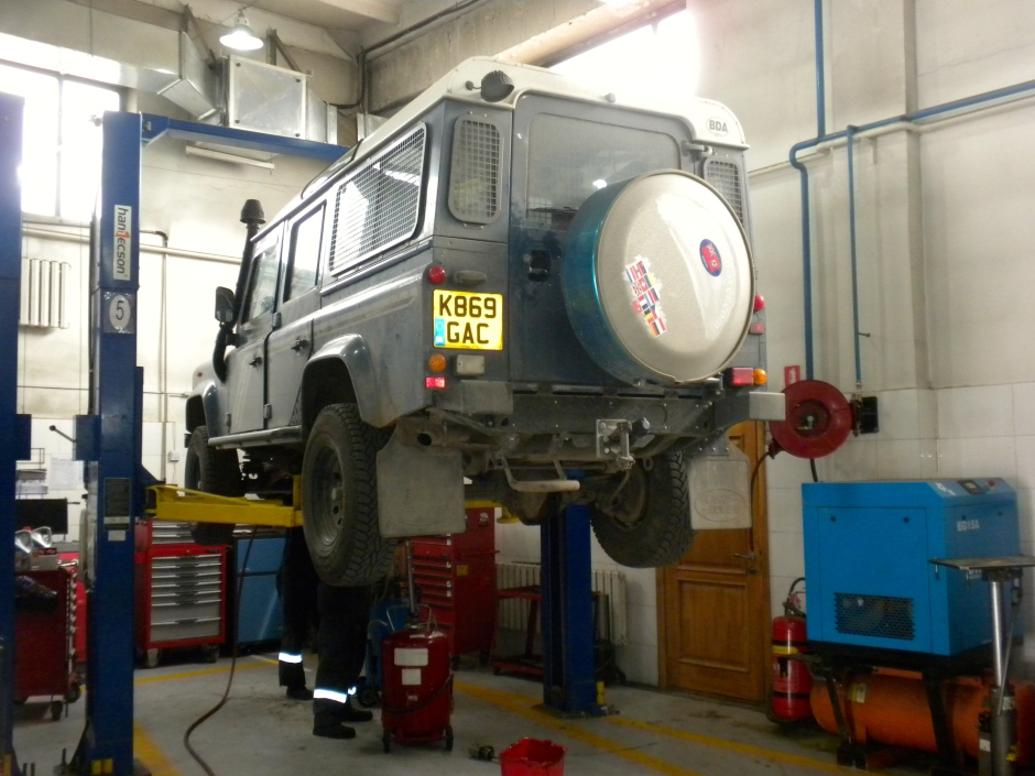 The Defender on the lift at Wagner Asia Automotive as the diffs are drained of fluid