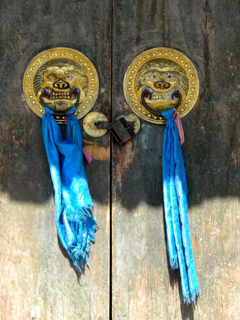 A pair of temple door pulls