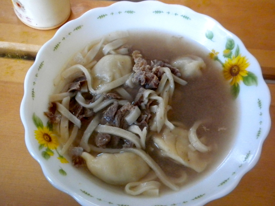 Soup with dumplings, noodles and mutton