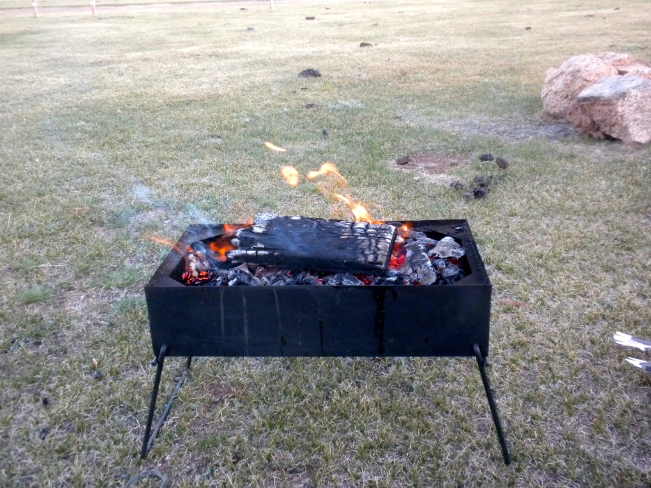 The Bush-Pig doubles as a camp-fire, burning wood and cow dung
