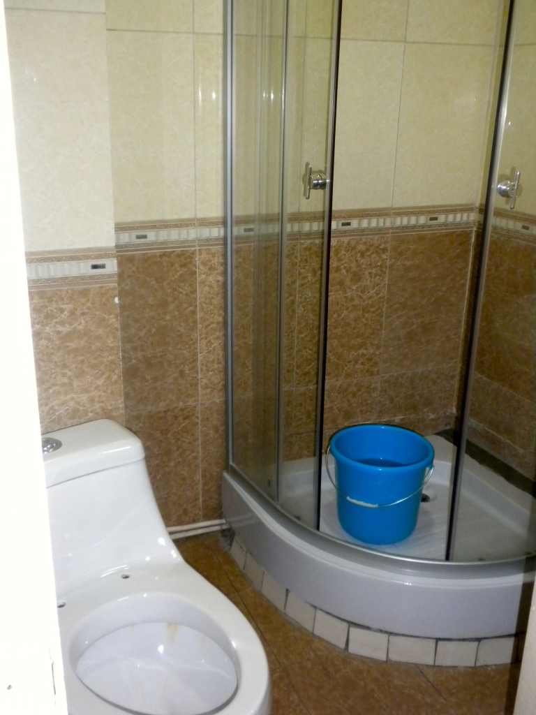 Bathroom complete with bucket for flushing the toilet