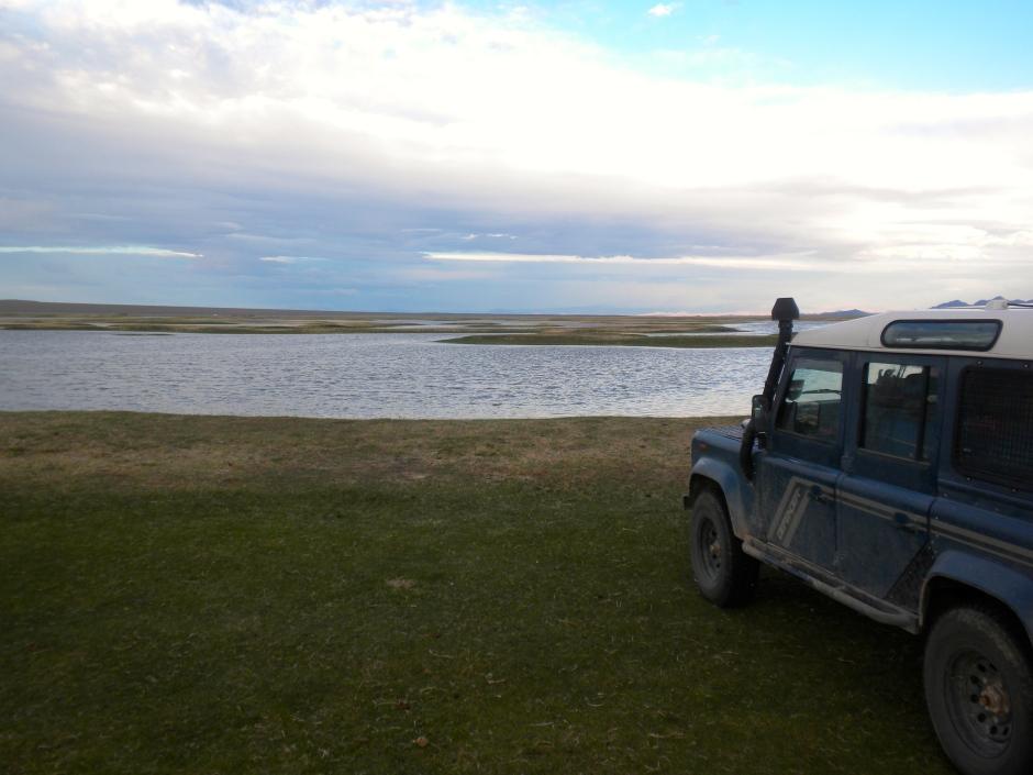 Parked on the shore of Khar Us Nuur (Dark Lake) where we slept inside the Defender