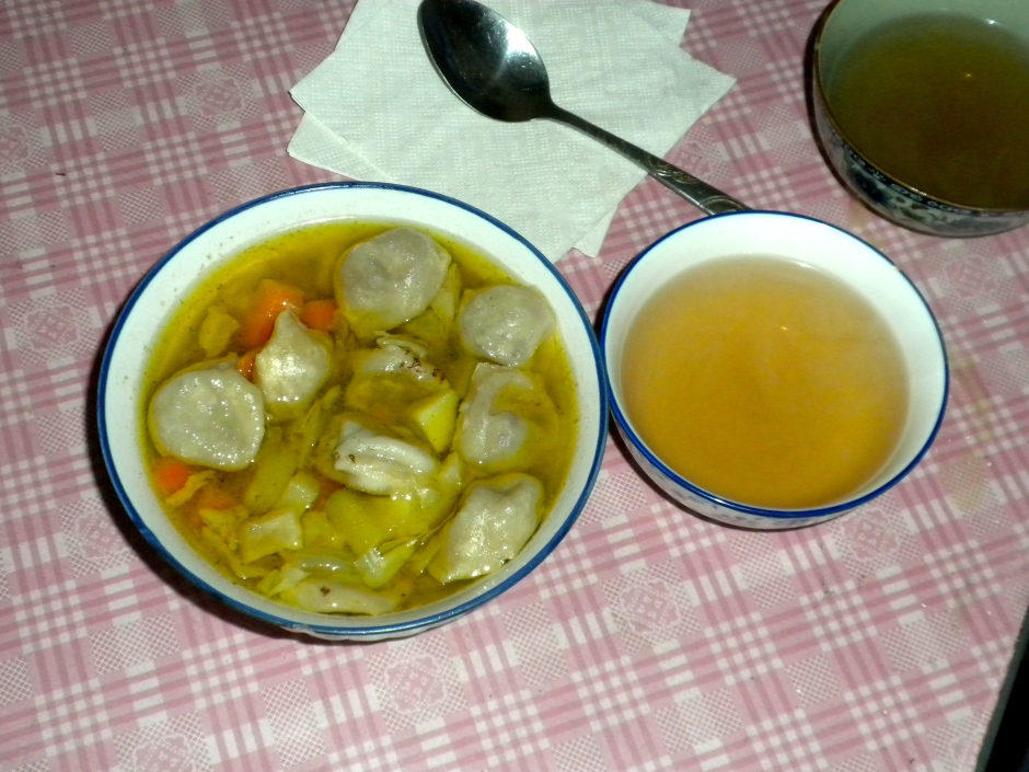 Hearty soup and a bowl of green tea