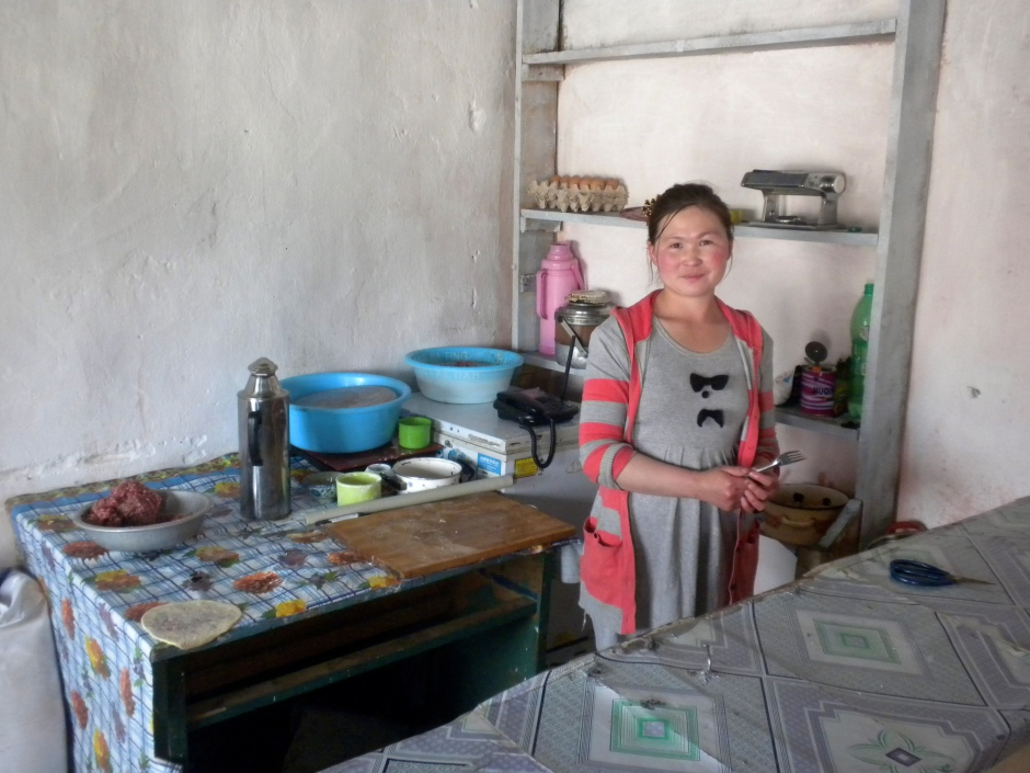 The proprietor of the small cafe in her kitchen