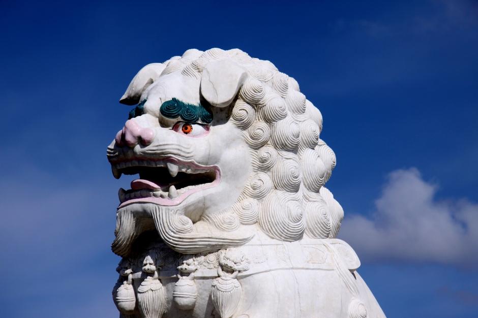 Lion alongside the Buddha