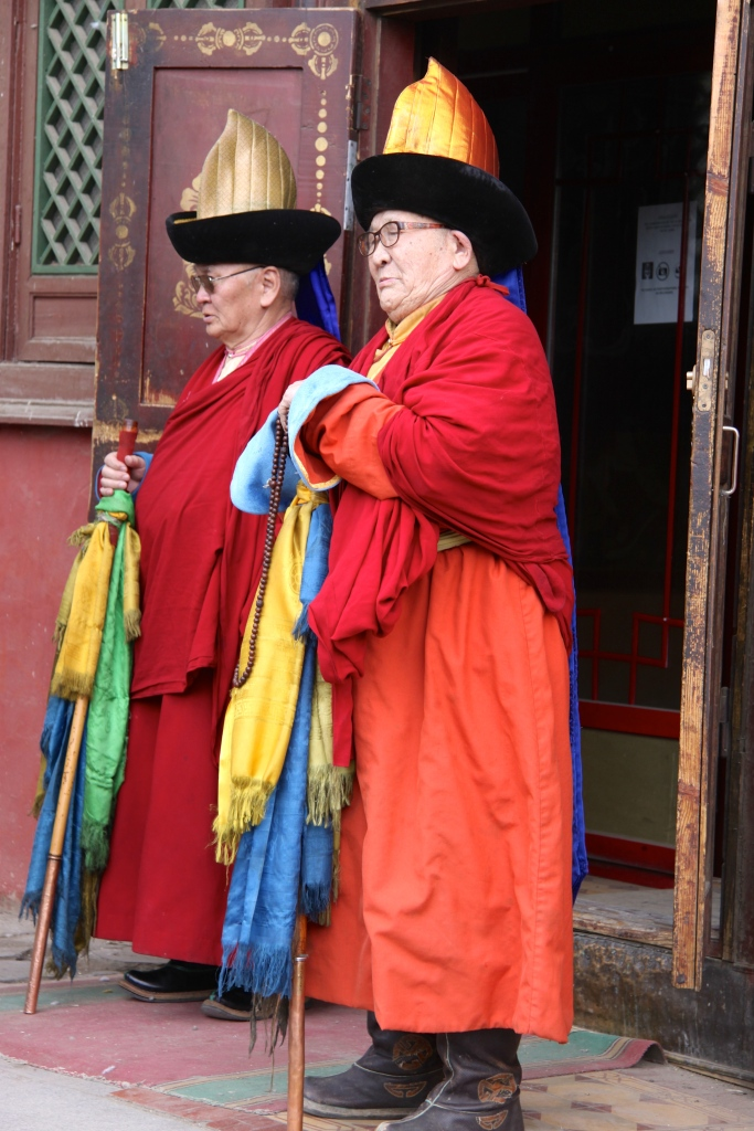 The two senior monks lead the way into the temple for prayers