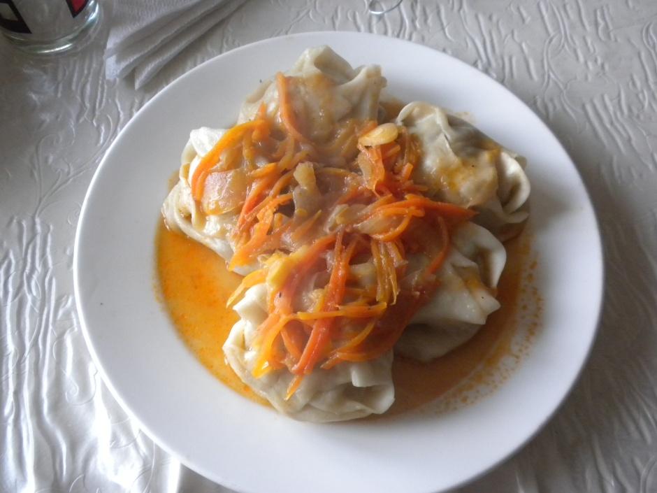 Kazakh meal of mutton-filled dumplings for dinner at a roadside cafe