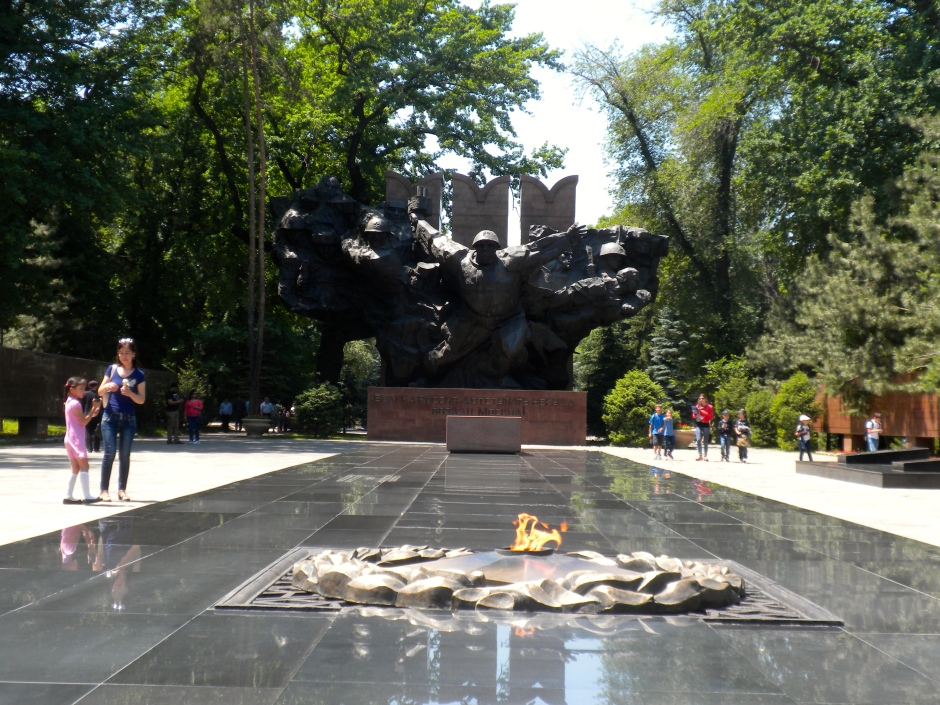 The eternal flame with large statue behind