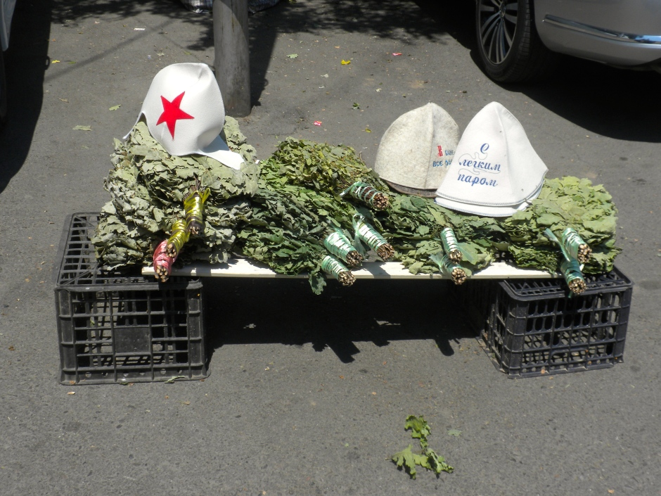 Hats and bunches of oak branches for sale outside the banya