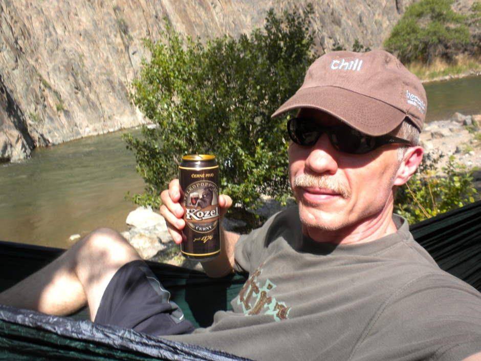 Enjoying a cold can of Kozel beer in my hammock by the Charyn River