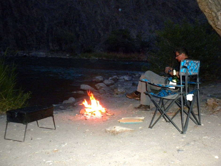 Evening camp-fire on the river bank