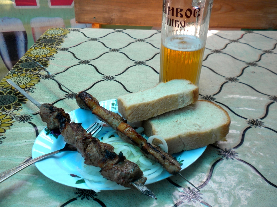 Two skewers of shashlik, bread and an ice-cold beer. This is the life!