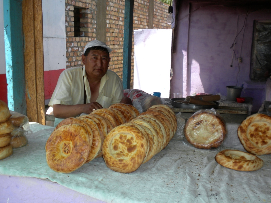 The owner of the bakery stall with his produce
