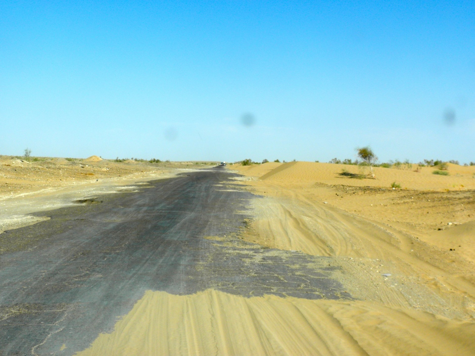 Pot-holes and sand in the road