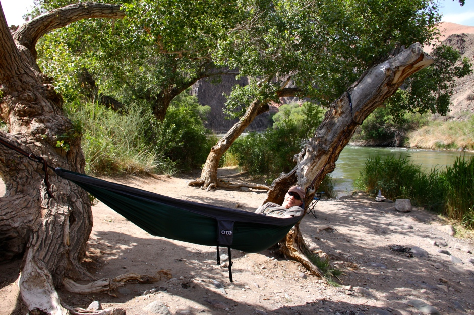 My ENO hammock strung between a couple of trees on the bank of the Charyn River