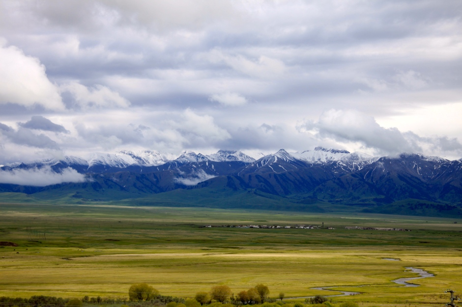 Tien Shan mountains and green meadows