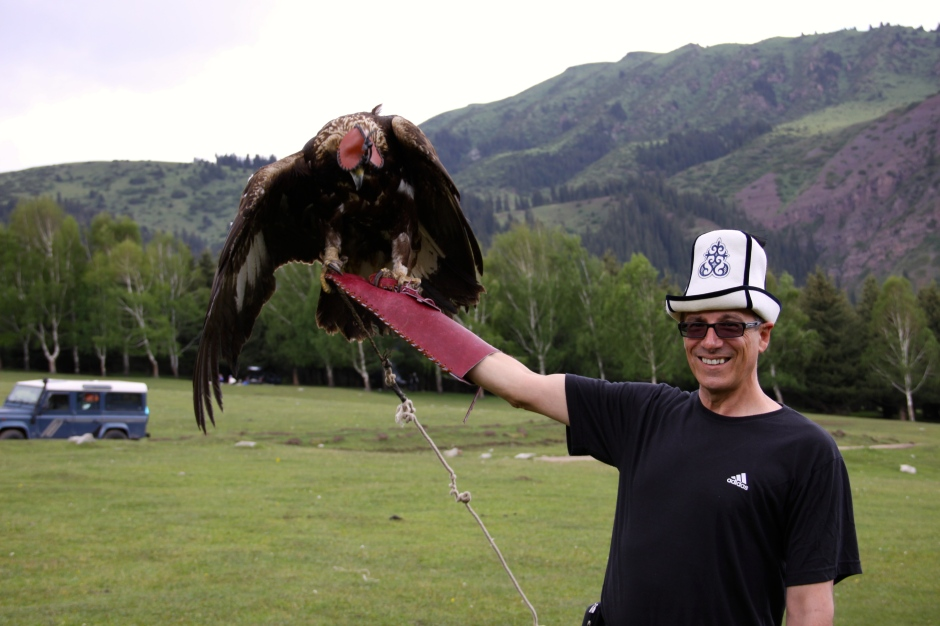 Klaus with eagle and his traditional Kyrgyz hat