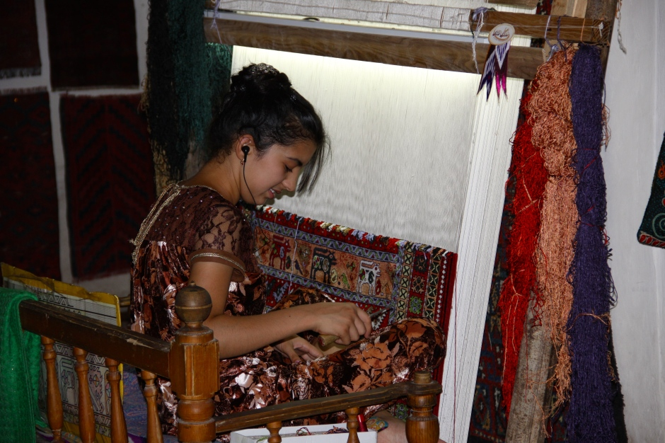 A close-up of a carpet being made
