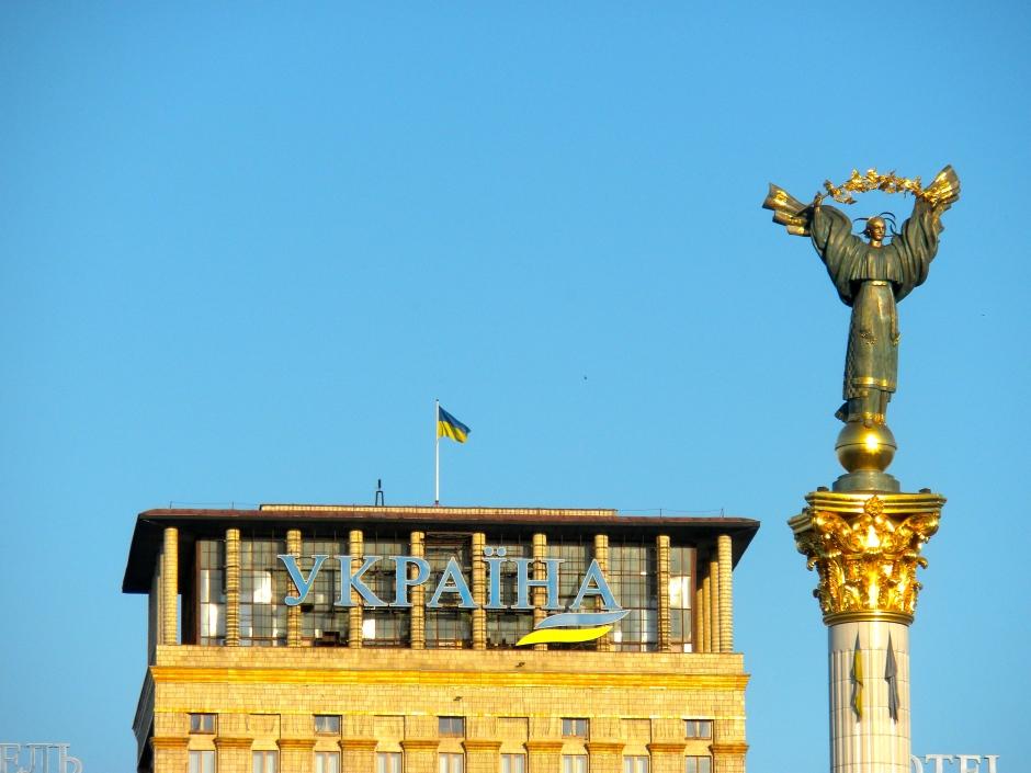 Setting sun illuminates the statue above the Maidan