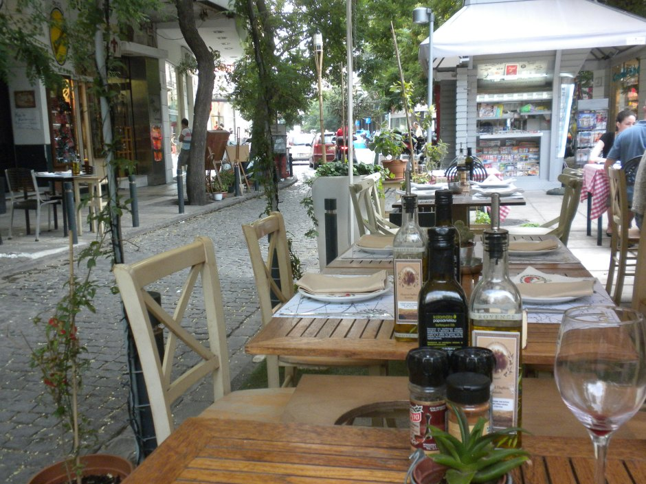 The outdoor cafe is located on a narrow cobble-stoned lane