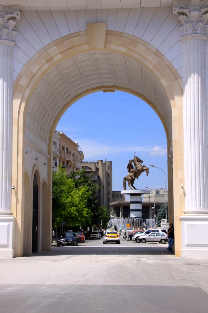 The 'Warrior on Horseback' statue, viewed through the 'Gate of Macedonia' arch