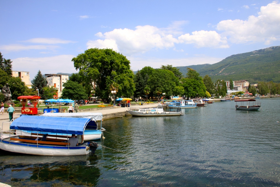 Boat captains seek business taking tourists on tours around the lake
