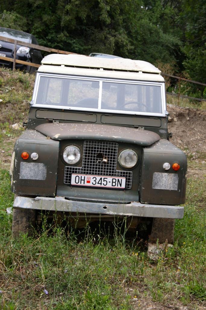 An old Series Land Rover has been parked unused for two years next to the Basilica.