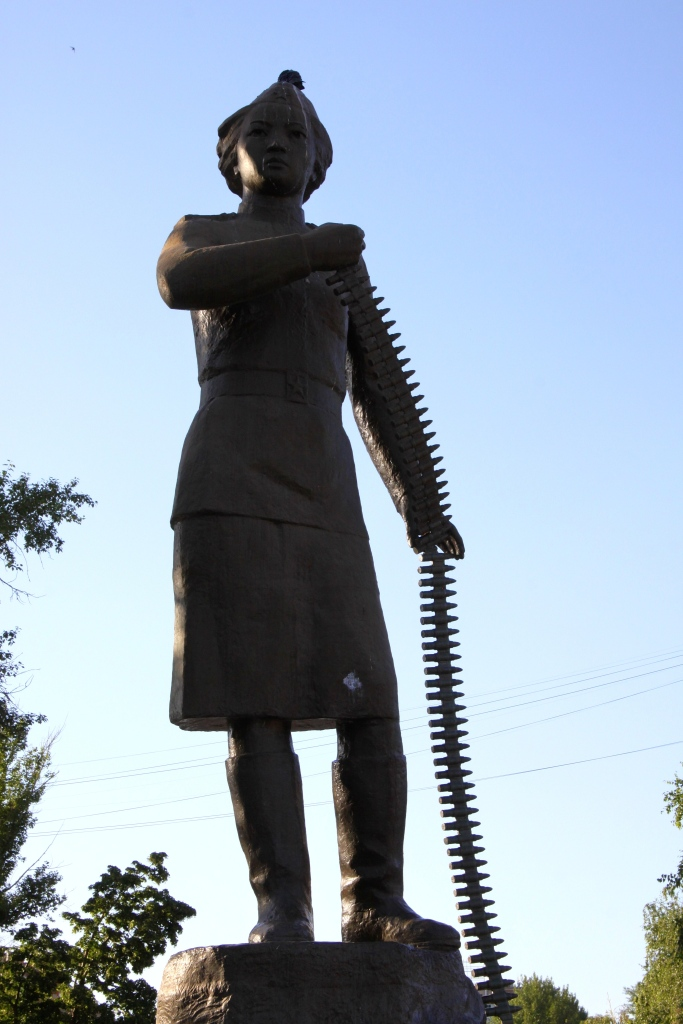 Statue of woman with a belt of ammunition!