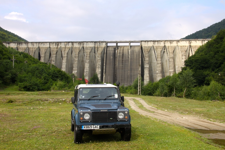 The Defender strikes a pose in front of the dam