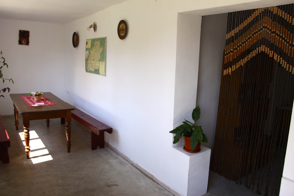 Recreation room - and a small room with a desk behind the beaded curtain