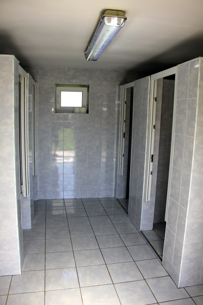 Men's bathroom: toilets on the left and showers on the right