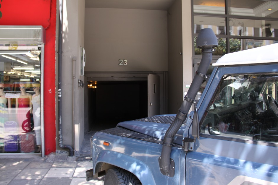 The Defender outside the hotel 'looking' at the vehicle parking elevator