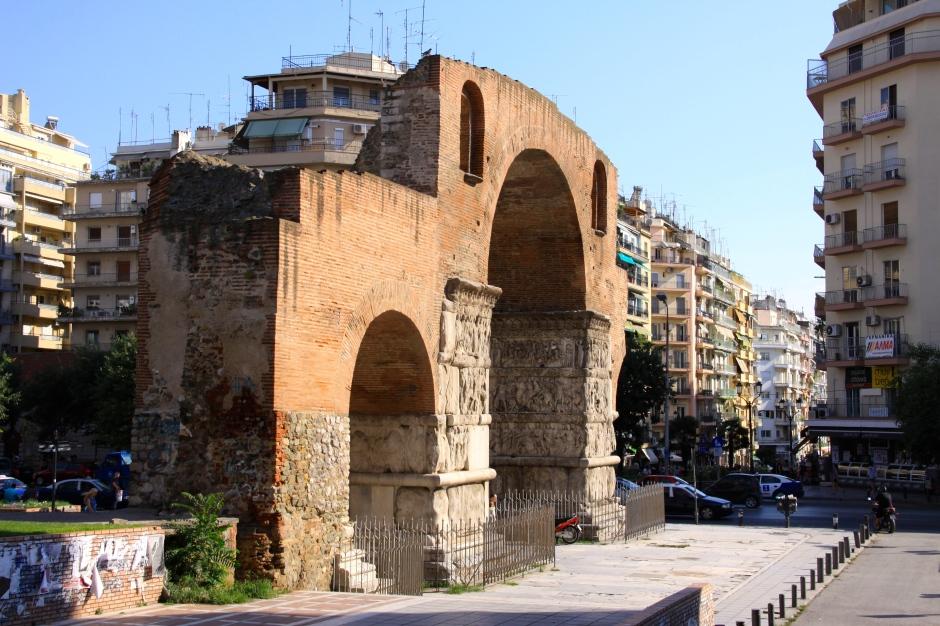 The remaining part of the Galerius Arch stands in the middle of a modern city