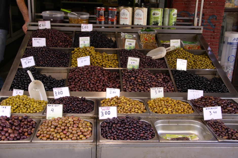 An assortment of olives for sale in the market